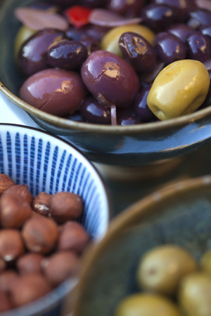Olives and nuts in bowls for a buffet