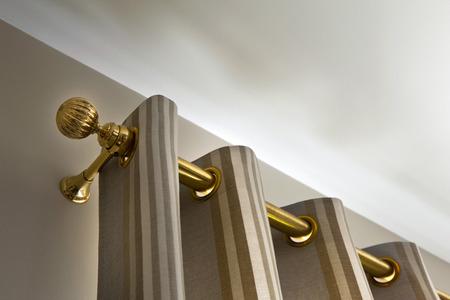 Photo pour Brass curtain rod in a house - image libre de droit
