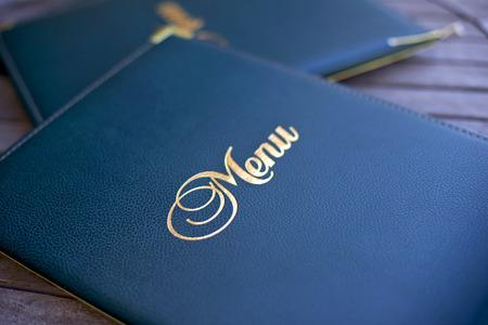 Photo pour Close up of a stylish menu on the table at a restaurant - image libre de droit