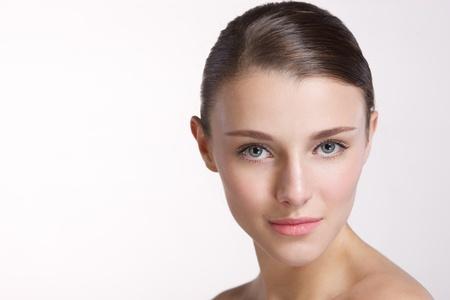 Beautiful young elegant model woman posing in studio
