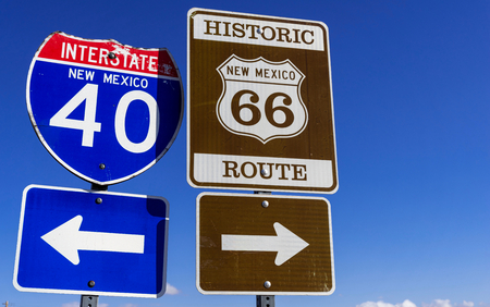 a group of Highway markers on historic highway 66 and interstate 40 in the American southwest