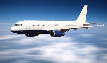 Big jet plane flying above clouds
