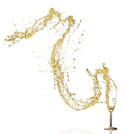Splashing champagne out of glass, isolated on white background