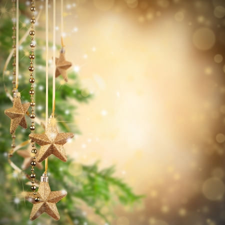 Christmas theme with golden glass stars and free space for textの写真素材
