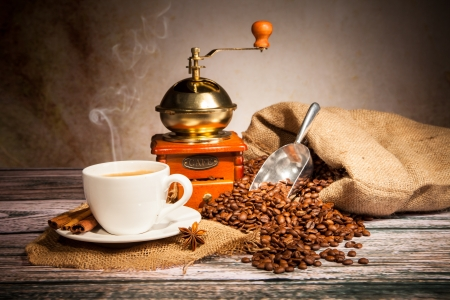 Coffee still life with wooden grinder