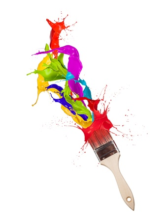 Colored paint splashes splashing from paintbrush on white background