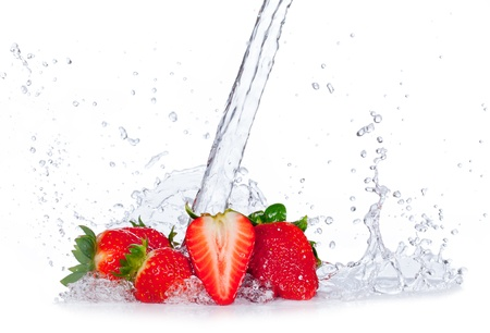 Fresh strawberries with water splash, isolated on white background