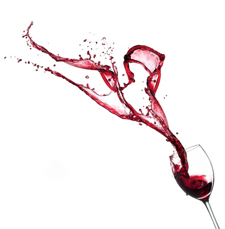 Red wine splashing from glass, isolated on white background