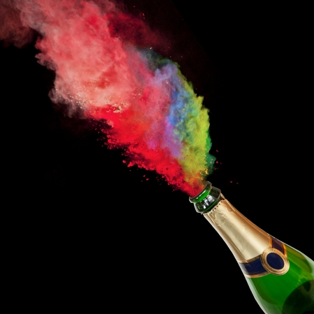 Bottle of champagne with colored splash on black background