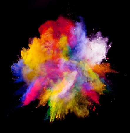 Freeze motion of colored dust explosion isolated on black background