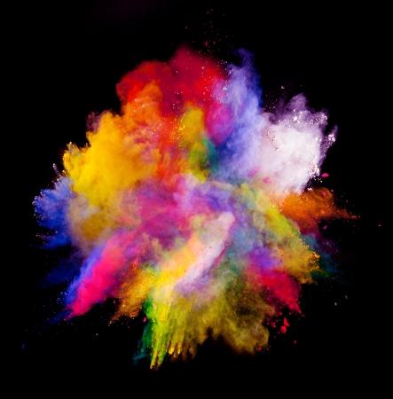 Foto de Freeze motion of colored dust explosion isolated on black background - Imagen libre de derechos
