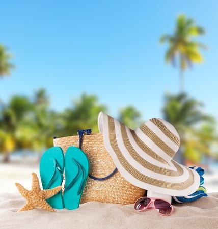 Foto de Summer concept with accessories on sandy beach - Imagen libre de derechos