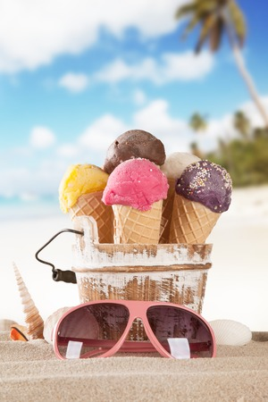 Photo pour Set of various kind of fruit ice cream on wooden deck with blur sea on background - image libre de droit