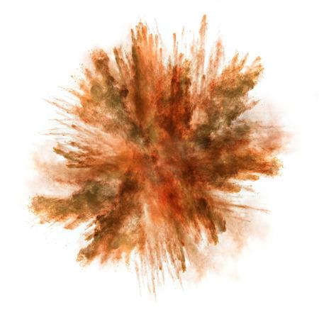 Freeze motion of orange dust explosion isolated on white background