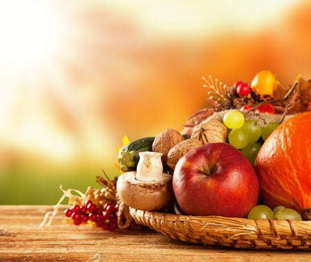 Photo for Autumn concept of traditional food  Mix of pumpkins, fruit and vegetable on wooden table with blur background  Free space for text - Royalty Free Image