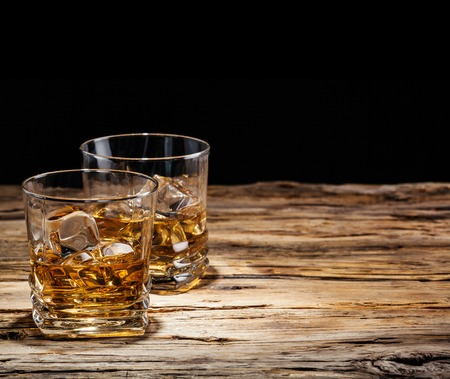 Whiskey drinks on wood