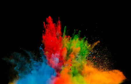 Freeze motion of colored dust explosion isolated on black