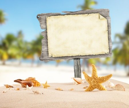 Summer beach with shells, stars and blank wooden poster. Blur azure sea on background