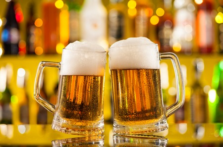Photo pour Jugs of beer placed on bar counter with copyspace - image libre de droit