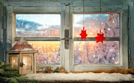 Atmospheric Christmas window sill decoration with beautiful sunset view