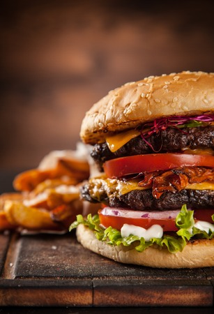 Photo for Delicious home made hamburger with lettuce and cheese, served on wooden desk - Royalty Free Image