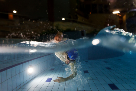 Photo pour Young man swimming in pool. Concept of healthy lifestyle. Underwater photography - image libre de droit