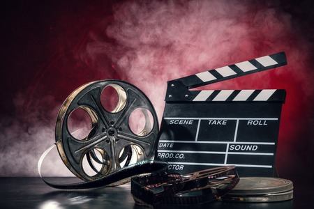Retro film production accessories still life. Concept of filmmaking. Smoke effect on background