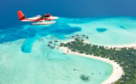 Photo for Sea plane flying above Maldives islands, Raa atol - Royalty Free Image