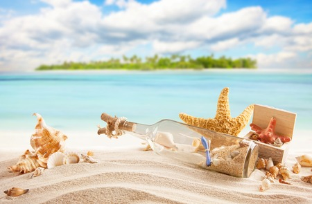 Sandy tropical beach with palm island, shells, bottle with message and starfish