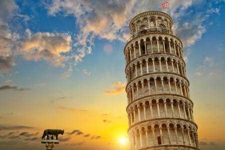 Leaning tower and the cathedral baptistery, Tuscany, Italy. Cultural heritage of UNESCO