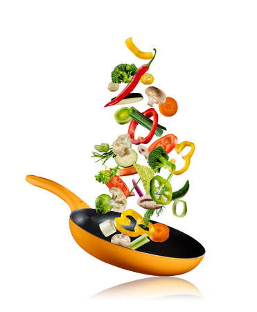 Photo for Fresh vegetables flying into a pan, isolated on white background - Royalty Free Image