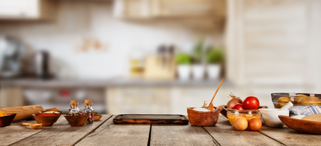 Photo pour Baking ingredients placed on wooden table, ready for cooking. Copyspace for text. Concept of food preparation, kitchen on background. - image libre de droit
