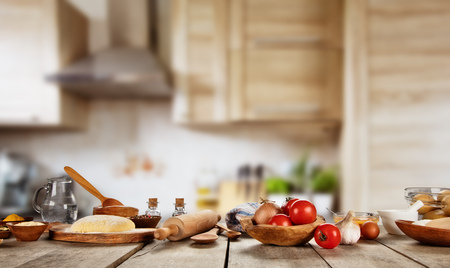 Foto de Baking ingredients placed on wooden table, ready for cooking pizza. Copyspace for text. Concept of food preparation, kitchen on background. - Imagen libre de derechos
