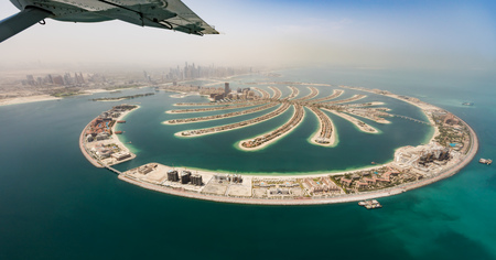 Photo pour Aerial view from airplane window, artificial palm island in Dubai. Panoramic view. - image libre de droit