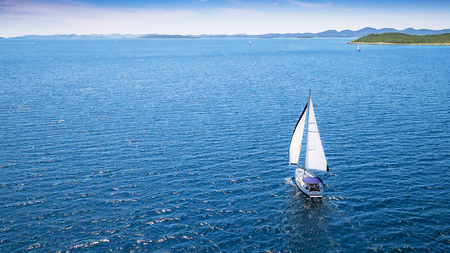 Photo pour Sailing boat on open water, aerial view. Active life style, water transportation and marine sport. - image libre de droit
