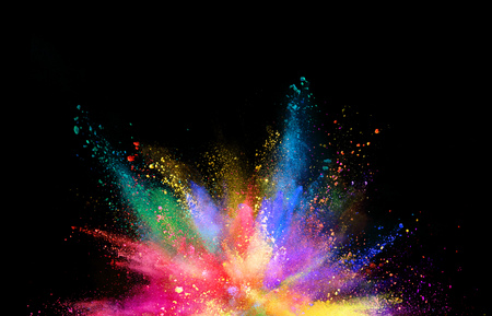 Photo pour Explosion of coloured powder isolated on black background. Abstract colored background - image libre de droit