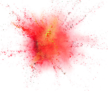 Foto de Explosion of coloured powder isolated on white background. Abstract colored background - Imagen libre de derechos
