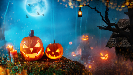 Photo for Spooky halloween pumpkins in dark mistery forest. - Royalty Free Image