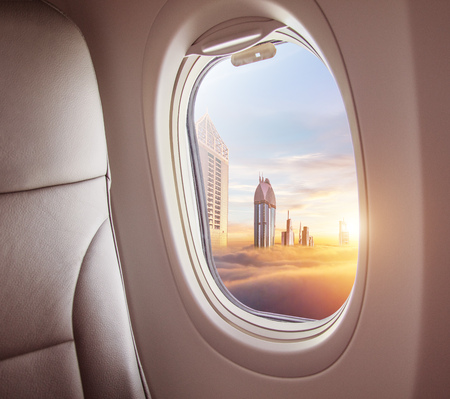 Photo pour Airplane interior with window view of Dubai city, UAE. Concept of travel and air transportation - image libre de droit