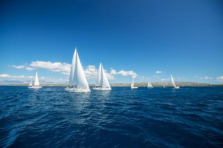 Photo pour Sailing yachts regatta competition. Summer sport and recreation activities. - image libre de droit