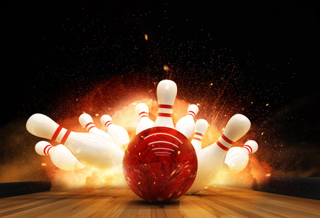 Photo pour Bowling strike hit with fire explosion. Concept of success and win. - image libre de droit