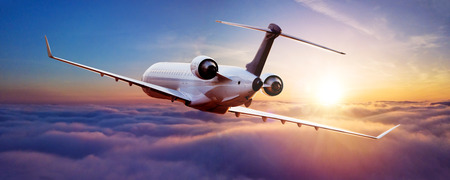 Photo for Private jet plane flying above clouds in beautiful sunset light. Modern and fastest mode of transportation, business life - Royalty Free Image