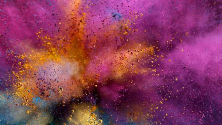 Foto de Explosion of colored powder isolated on black background. Abstract colored background - Imagen libre de derechos