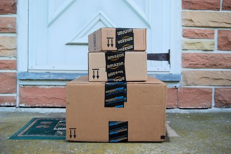Amazon packages on a front door step