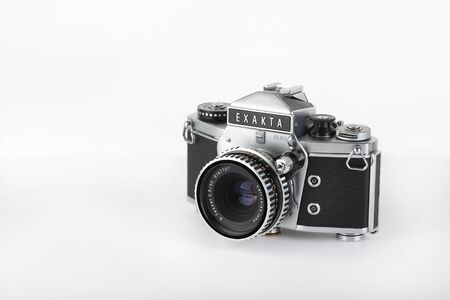 Photo for The old German 35 mm SLR film camera Exakta VX 1000 released 1967, with Carl Zeiss lens Tessar 2,8 50 mm lens on a white background. The last of the real camera Exakta. - Royalty Free Image