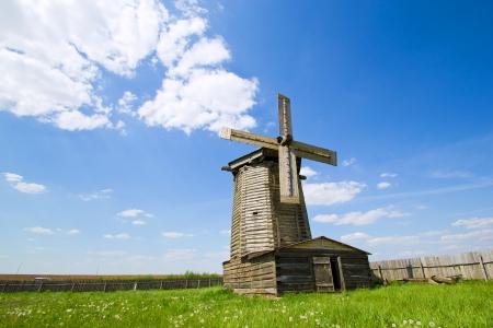 old wooden windmill in russian village