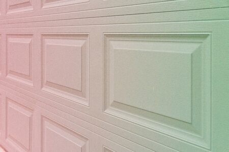 Photo for Trendy red to greenish holographic gradient garage door paneling. Colorful background with linear lines & square / rectangular panels that show close up perspective. Holo 90 / 80 style squared shapes - Royalty Free Image