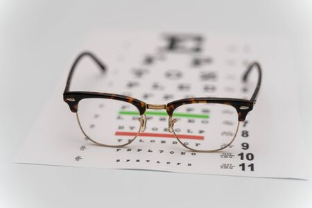 Photo pour Eye Exam, The testing Board for verification of the patien. Vision test board optometrist with glasses - image libre de droit