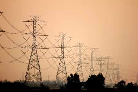 Electricity pylons and lines at sunset near Bangkok, Thailand