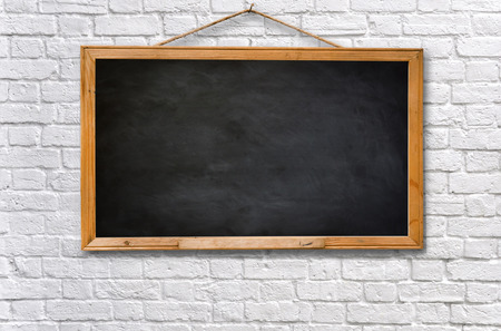 Foto de Empty black board on white brick wall texture background - Imagen libre de derechos